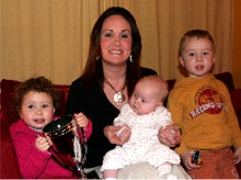 Sarah Quigley-Burns pictured with her children Líoda, Saorla and Cillian.
