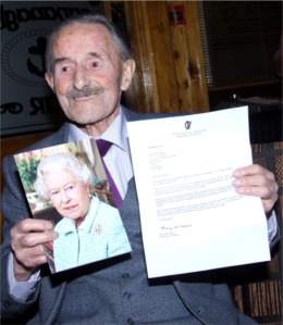 centenarian john sweeney pictured with his 100th birthday greetings from irish president mary mcaleese and queen elizabeth ii